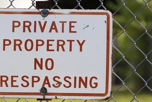 fence with no trespassing sign