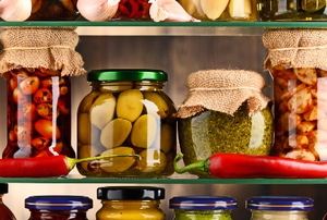 food goods in jars on a glass shelf