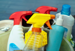various cleaning supplies in a bucket