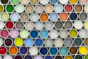 A selection of colorful paint cans.