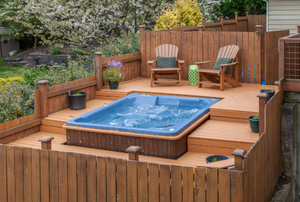 a hot tub with surrounding deck