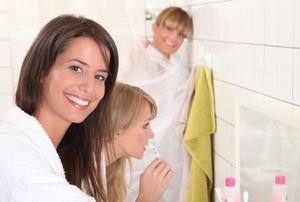 girls in a dorm bathroom