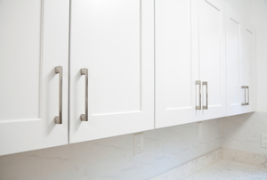 white painted veneer kitchen cabinets with metal hardware