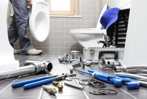 a bathroom full of tools and toilet repair