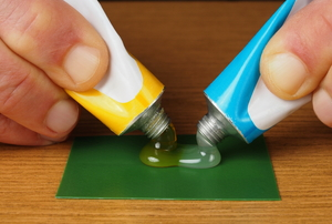 gel adhesives being applied to a green surface
