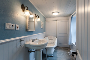 bathroom with a pedestal sink