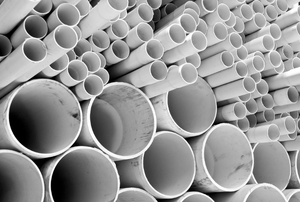 A stack of white cpvc pipe.