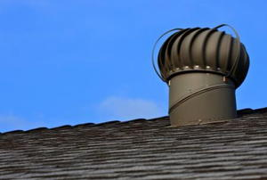 An mushroom-shaped air vent on a roof.