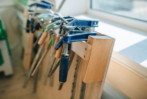 Row of clamps on a board