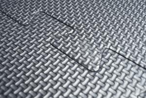 Grey interlocking mat on garage floor