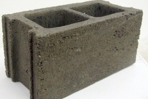 An isolated cinder block on a white background.