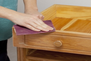 sanding a wooden drawer