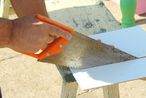 hand slicing tile with a panel hacksaw
