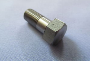 A lone hex bolt on a blue background.