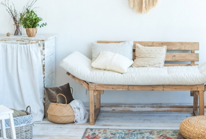relaxing rustic design including wooden couch with covered cushions
