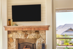 Plasma TV over fireplace.