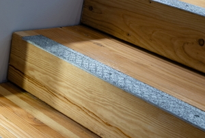 Wooden stairs with slip prevention strip