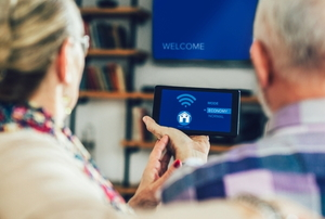 an older couple uses their smart home device