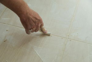 Applying grout in between tiles