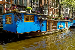 a blue houseboat on the water