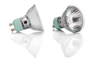 A pair of halogen light bulbs on a white, reflective surface.