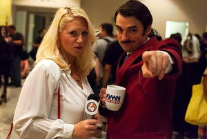 A couple dressed as the characters from the movie Anchorman.