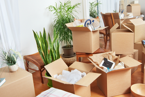 moving boxes with things piled into them