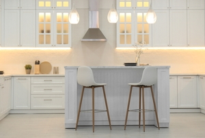 All white kitchen with small eating island