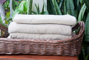 folded towels in a basket
