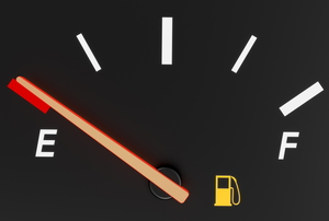 An empty gas gauge with the fuel light on.