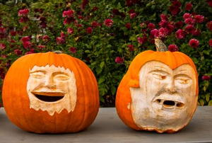 Two pumpkins with creepy faces.