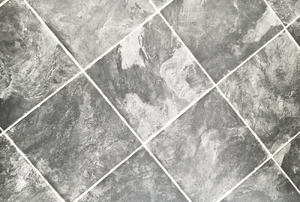 grey and white tile-look vinyl flooring