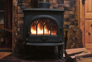 a wood stove in a cabin style room