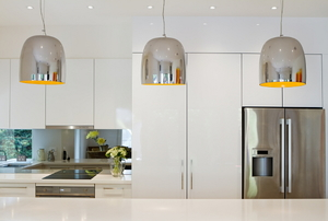 Three modern pendant lights in a contemporary style kitchen.