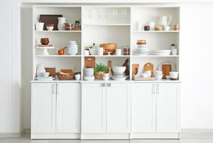 white shelving cabinet unit with displayed items