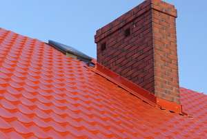 Chimney protruding from a red roof