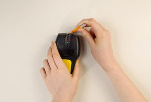 marking location of a wall stud using a stud finder