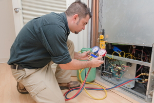 A man installing forced air heating.