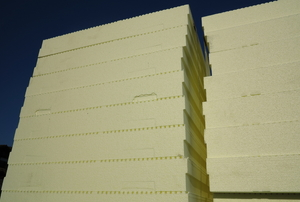 Two adjacent stacks of rigid foam board insulation.