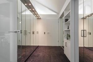 walkway with mirrored closet doors