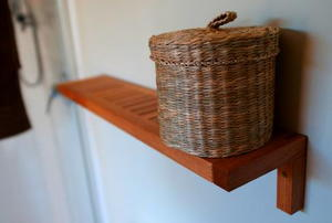 A wicker basket on a shelf.