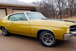 a mustard yellow Chevelle car