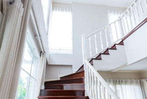 A white staircase surrounded by windows.