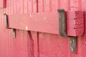 close-up of reddish pink wooden ledge-and-brace door