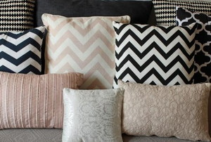 pillows with various designs, some in zig zags
