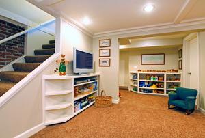 A basement with carpet.