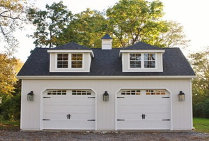 Double car garage with carriage doors