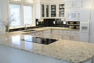 Granite countertop in a white kitchen.