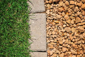 grass and rock separated by pavers