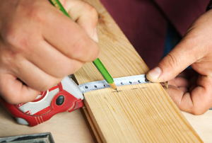 Marking lumber with a measurement